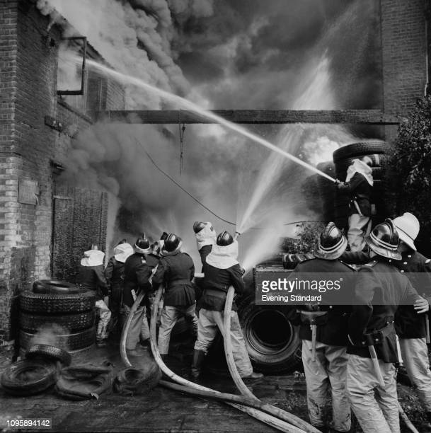 Firefighters at work to extinguish a fire at 19 Junction Road London UK 16th July 1975