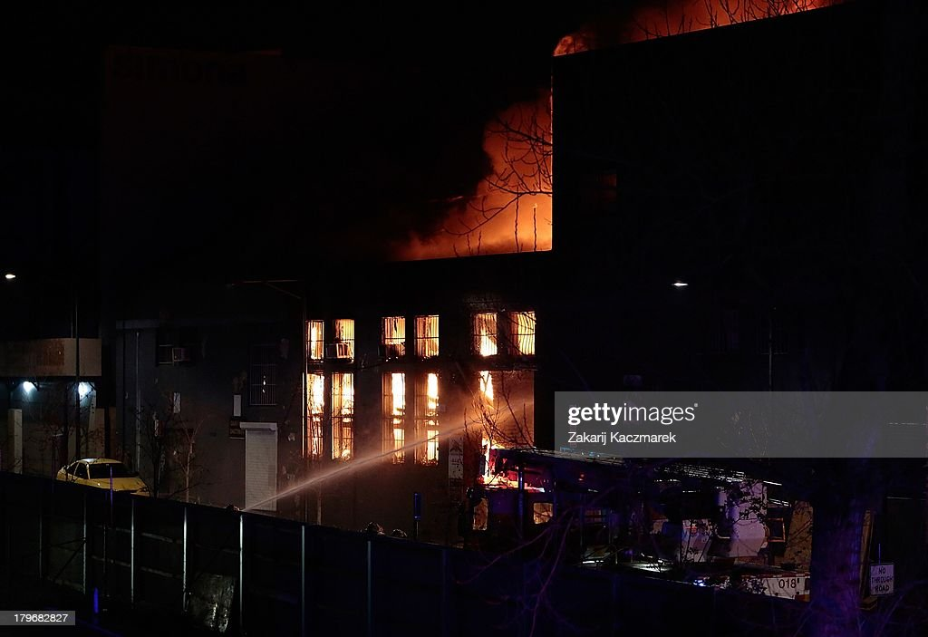Firefighters attempt to bring a fire under control in O'Connor Street, Chippendale, a mixed residential and commercial area, on September 6, 2013 in Sydney, Australia.