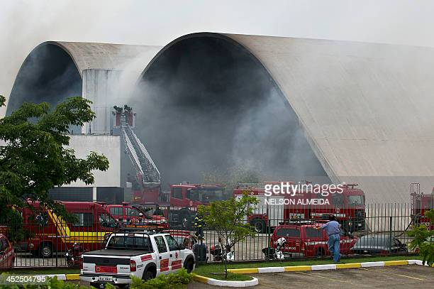 Firefighters attempt to extinguish a fire in a building of the Latin American Memorial in Sao Paulo Brazil on November 29 2013 The Latin American...