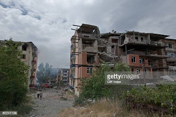 Firefighters attempt to extinguish fires in an apartment building after the area was bombed by Russian jets on August 9 2008 in Gori Georgia After...