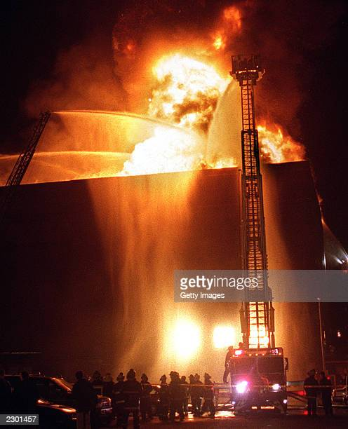 Firefighters attempt to put out a general alarm fire at the Worcester Cold Storage building Worcester Massachusetts December 3 1999 Six firefighters...