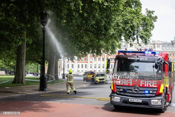 Firefighters attend a blaze within a gas lamp behind Downing Street after it malfunctioned and ignited on June 24, 2021 in London, England.