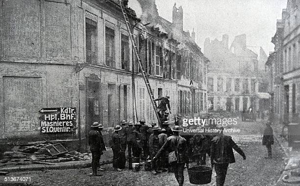 Firefighters attend a fire during the aftermath of the battle for Cambrai France 1918 World war one
