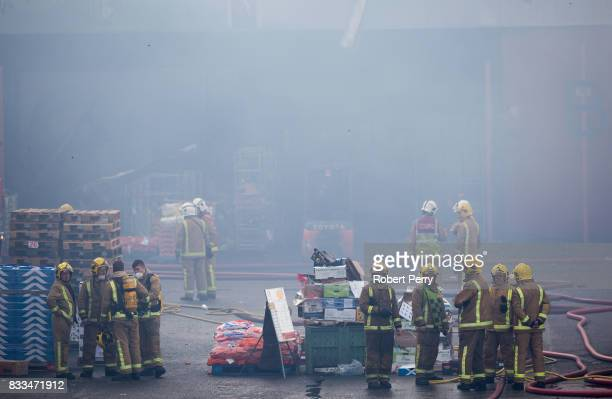 Firefighters attend the scene of a blaze at Blochairn Fruitmarket on August 17 2017 in Glasgow The Scottish Fire and Rescue Service are tackling a...