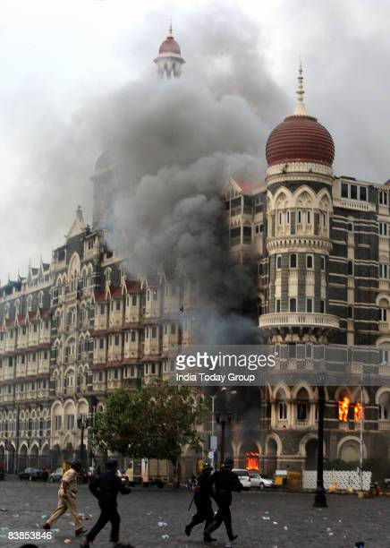 Firefighters attend to a fire as it burns at Taj Mahal Palace Tower Hotel following an armed siege on November 29 2008 in Mumbai India Indian...