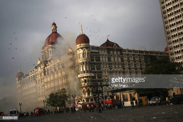 Firefighters attend to a fire as it burns at Taj Mahal Palace & Tower Hotel following an armed siege on November 29, 2008 in Mumbai, India. Indian...
