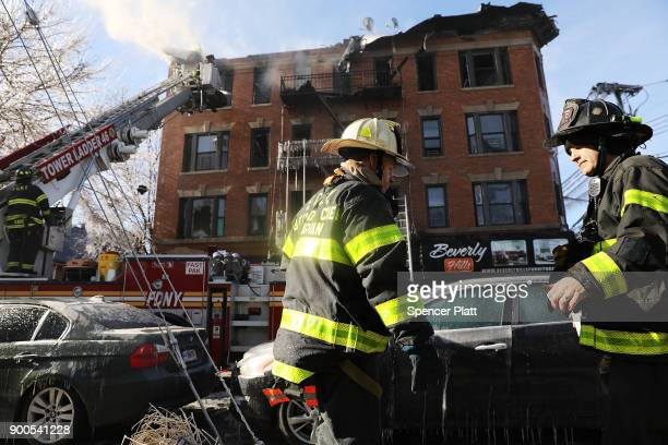 Firefighters battle a 7alarm fire in the Bronx on January 2 2018 in New York City The fire which started around 530 am on a frigid Tuesday is...