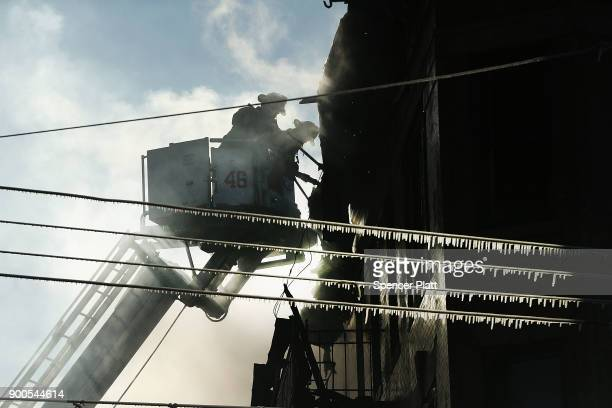 Firefighters battle a 7alarm fire on January 2 2018 in the Bronx borough of New York City The fire which started around 530 am on a frigid Tuesday is...