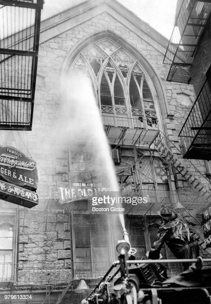 Firefighters battle a blaze at the shuttered Old Howard Theatre in Boston on June 20 1961