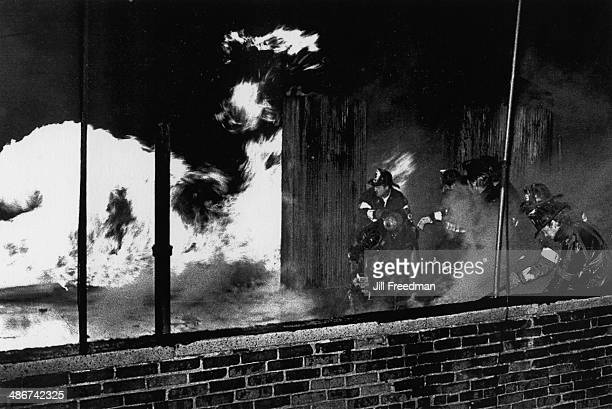 Firefighters battle a blaze in Harlem New York City 1976