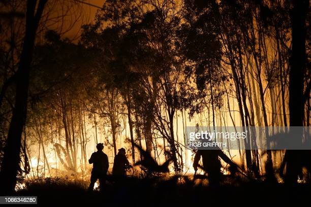 TOPSHOT Firefighters battle a blaze on Fingerfield road at the Deepwater National Park area of Queensland on November 29 2018 Thousands of people...