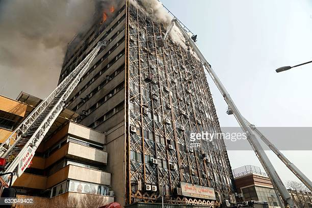 Firefighters battle a blaze that engulfed Iran's oldest highrise the 15storey Plasco building in downtown Tehran on January 19 2017 State television...