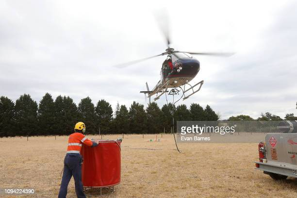 Firefighters battle a blaze that forced the evacuation of residents of 170 homes in the Tasman district February 6, 2019 in Richmond, near Nelson,...