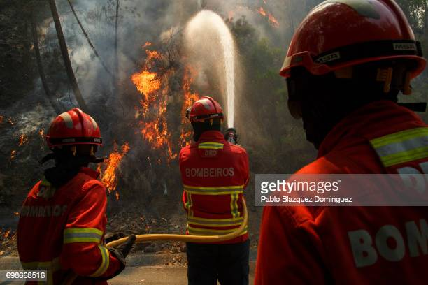 Firefighters battle a fire after a wildfire took dozens of lives on June 20 2017 in Mega Fundeira village near Picha in Leiria district Portugal On...