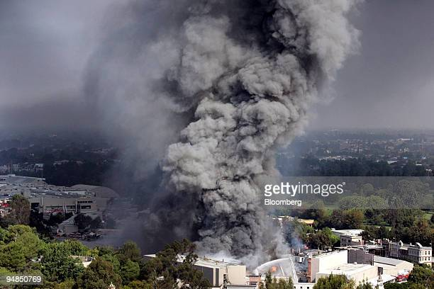 Firefighters battle a fire at Universal Studios in Universal City, California, U.S., on Sunday, June 1, 2008. King Kong, the giant ape from Skull...