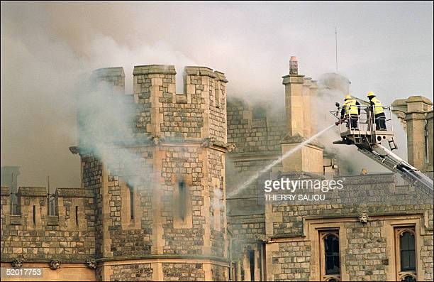 Firefighters battle a huge blaze at Windsor Castle, a royal residence 30 miles west of London, 20 November 1992. The blaze, that reportedly started...