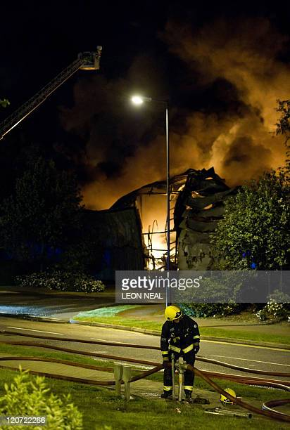Firefighters battle a massive blaze at the Sony distribution centre in Waltham Abbey north of London Violence escalated across London and at least...