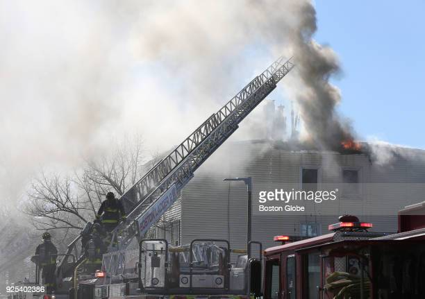 Firefighters battle a multialarm fire at 238 Havre St in East Boston on Feb 27 2018 One Boston firefighter suffered a burn injury and four residents...