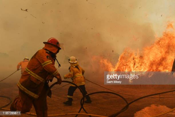 Firefighters battle a spot fire on November 13, 2019 in Hillville, Australia. Catastrophic fire conditions - the highest possible level of bushfire...
