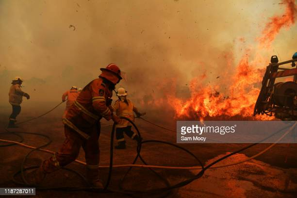 Firefighters battle a spot fire on November 13 2019 in Hillville Australia Catastrophic fire conditions the highest possible level of bushfire danger...
