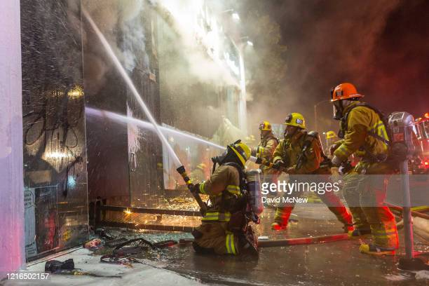 Firefighters battle a structure fire on Melrose Avenue in the Fairfax District during demonstrations following the death of George Floyd on May 30...