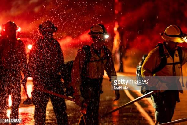 Firefighters battle a wildfire in Glendale near Los Angeles, California on August 25, 2019.