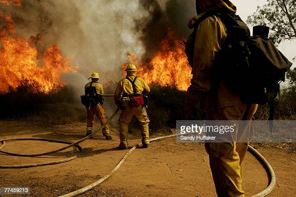 Firefighters battle a wildfire October 23 2007 in the Del Dios area of Escondido California The Witch Fire which started outside of Ramona California...