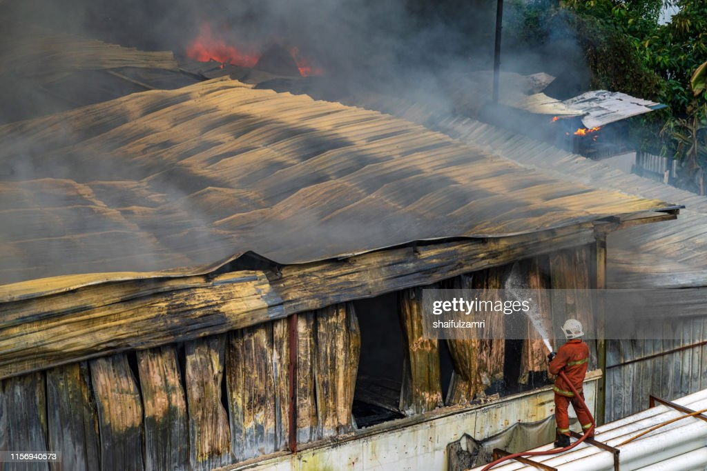 Firefighters battle a wildfire : Stock Photo
