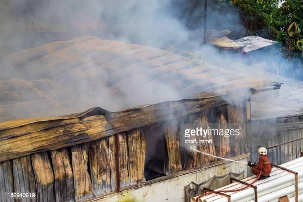 firefighters battle a wildfire - shaifulzamri stock-fotos und bilder