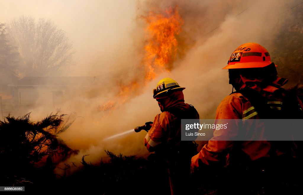 Firefighters battle the Creek Fire as it burns near a church along Foothill Boulevard in Sylmar on Tuesday, Dec. 5, 2017. The fire started at about 3:42 a.m. in the area of Gold Creek and Little Tujunga roads and has burned more than 11,000 acres.