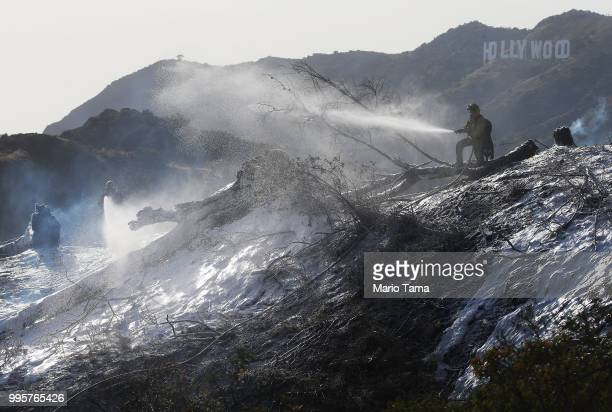 Firefighters battle the Griffith fire at Griffith Park, with the Hollywood sign in the background, on July 10, 2018 in Los Angeles, California....