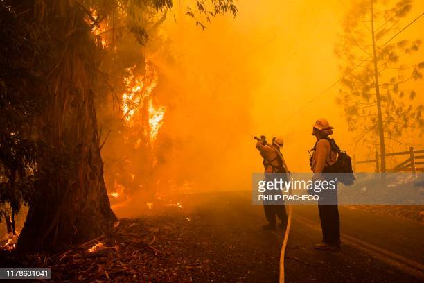 TOPSHOT Firefighters battle the Kincade Fire along Chalk Hill Road in Healdsburg California on October 27 2019 Powerful winds were fanning wildfires...