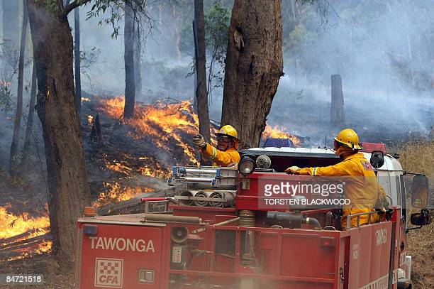 Firefighters battle to hold the containment lines to prevent a bushfire in the Kiewa Valley from reaching the town of Dederang in the Victoria Alps...