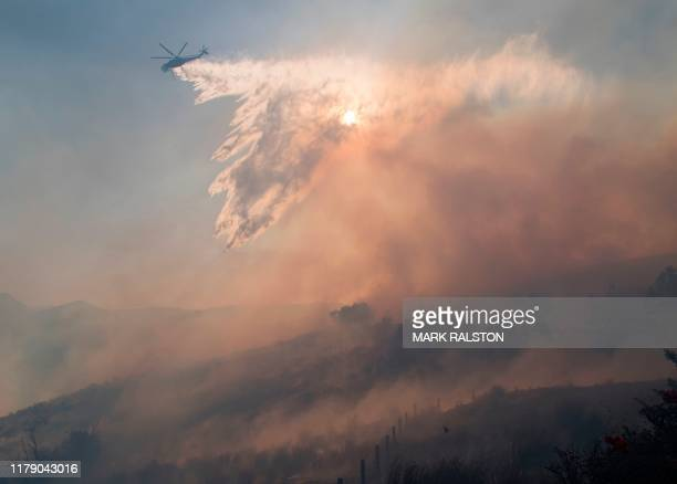 Firefighters battle to protect area around the Reagan Library from the Easy Fire in Simi Valley California on October 30 2019 Firefighters made...