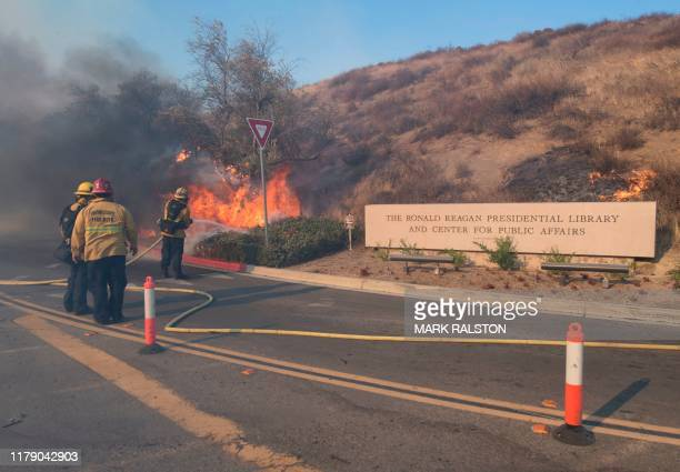 Firefighters battle to protect the Reagan Library from the Easy Fire in Simi Valley California on October 30 2019 Firefighters made progress battling...