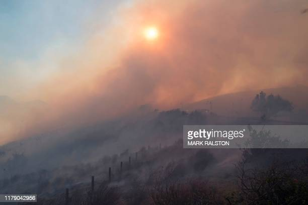 Firefighters battle to protect the Reagan Library from the Easy Fire in Simi Valley California on October 30 2019 Firefighters in California battled...