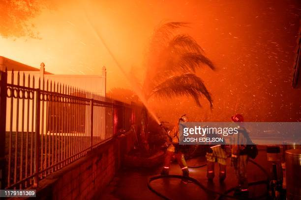 Firefighters battle windwhipped flames engulfing multiple homes during the Hillside Fire in the North Park neighborhood of San Bernardino California...