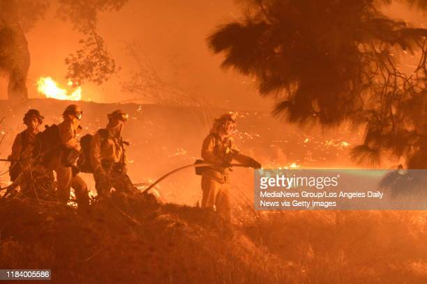 Firefighters battled a blaze near the Getty Center early Monday morning Los Angeles CA on Oct 28 2019