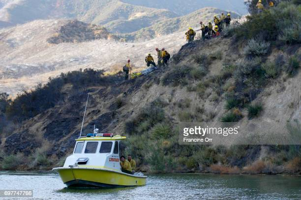 Firefighters being transported by Los Angeles County Life guards across Castaic Lake A fastmoving brush fire yesterday near Castaic Lake has grown to...