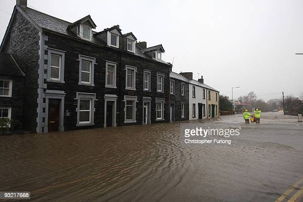 Firefighters brave flood waters to rescue people from rising waters in Keswick in the Lake District on November 19, 2009 in Keswick, United Kingdom....