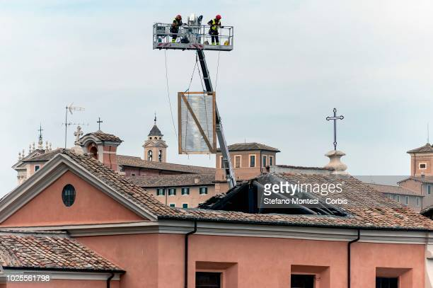 Firefighters bring to safety a painting after the collapse of the roof on the San Giuseppe dei Falegnami Church at the Roman forum on August 31 2018...