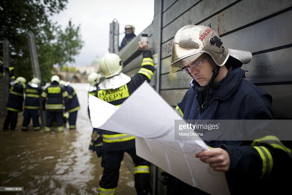Firefighters build anti-flood barriers in the Kampa district on June 2, 2013 in Prague, Czech Republic. Flood put west and northern regions of Bohemia in danger.