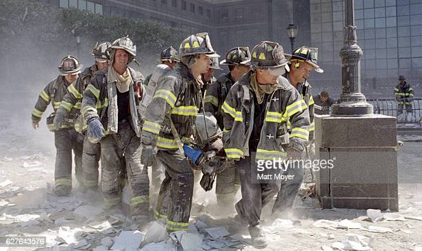 Firefighters carry fellow firefighter, Al Fuentes, who was injured in the collapse of the World Trade Center on Sept. 11, 2001.