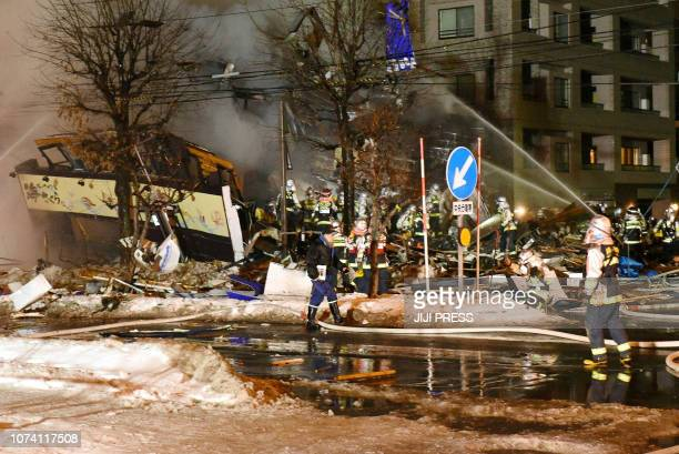 Firefighters carry on rescue works after an explosion at a restaurant in Sapporo in the northern Hokkaido prefecture on December 16 2018 Dozens have...