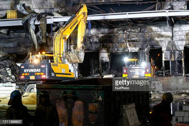 Firefighters carry out a search and rescue operation at the site of a fire that broke out at a warehouse construction site in Icheon, Gyeonggi...