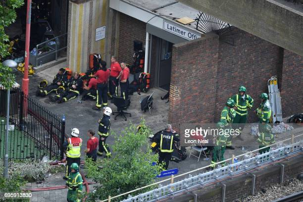 Firefighters change shift close to the burning 24 storey residential Grenfell Tower block in Latimer Road West London on June 14 2017 in London...