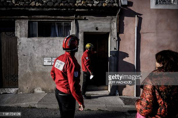 Firefighters check houses in Le Teil southeastern France on November 11 after an earthquake with a magnitude of 54 hit the area An unusually strong...