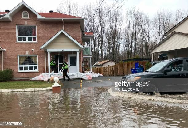Firefighters check on people in their homes in preparation for increased flooding in Gatineau Quebec on April 24 2019 Flooding in eastern Canada...
