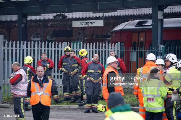 Firefighters continue dampening down and investigating the large fire at Nottingham train station on January 12 2018 in Nottingham England Up to ten...
