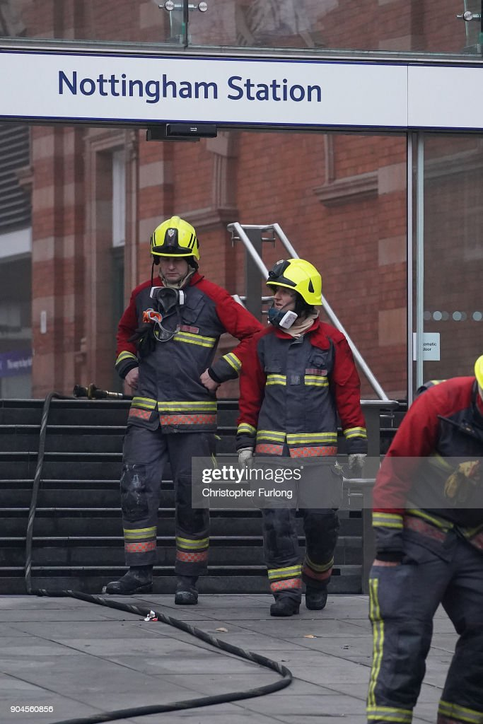 Firefighters continue dampening down and investigating the large fire at Nottingham train station on January 12, 2018 in Nottingham, England. Up to ten fire crews have been fighting the flames at Nottingham Train station since 6.30am. The fire is believed to have started in a toilet and has caused widespread travel interruptions.